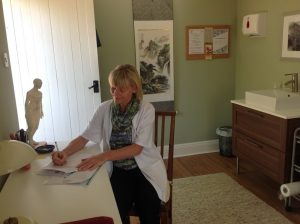 ashdon-acupuncture-charmian-at-desk